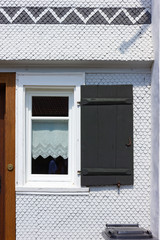white wooden farmhouse facade and details in allgau south germany