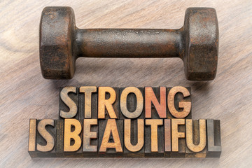 strong is beautiful - word abstract in vintage wood type