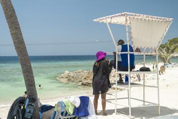 Woman talking to a lifeguard in Haiti