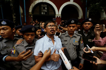 Detained Reuters journalist Wa Lone speaks to the media while leaving Insein court in Yangon