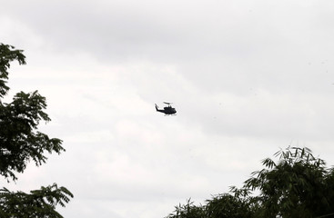 Military helicopter seen near the Tham Luang cave complex in the northern province of Chiang Rai