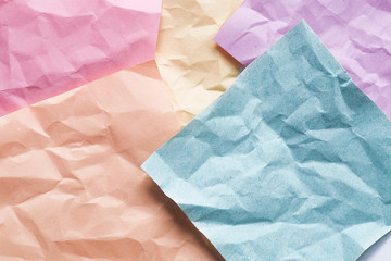 Background of crumpled sticky colored notes