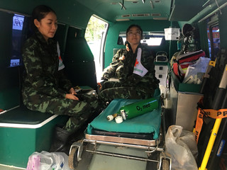 Medics wait in one of nine ambulances stationed outside the Tham Luang cave mouth, in the northern province of Chiang Rai