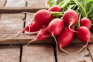 Fresh bunch of radish on rustic  table