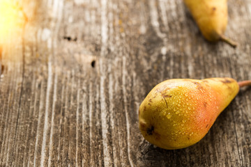 Fresh organic pears on old wooden table