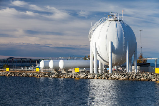 Spherical gas holder stands on sea coast