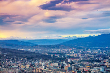 Wall Mural - Aerial panoramic view of Tbilisi city at sunset, Georgia country, Europe