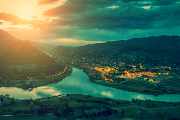 Wall Mural - Evening view of Mtskheta city and Kura with Aragvi rivers from Jvari Monastery. Georgia country