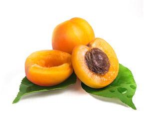 Fresh yellow apricots with green leaf on a white background