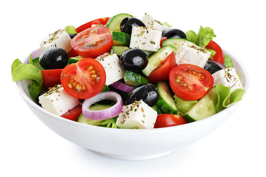 Salad with cheese and fresh vegetables isolated on white background. Greek salad.