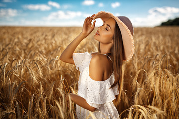 Beautiful blonde girl in a wheat field