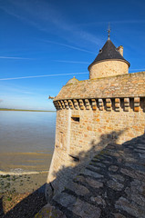 Ancient defense tower. Mont Saint Michel Abbey. Spring morning landscape. Normandy, France, Europe