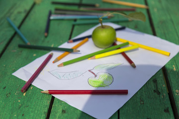 the child draw fruits with colorful pens in the nursery or school for activity concept.
