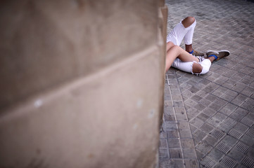 A couple lies on the ground on the fourth day of the San Fermin festival in Pamplona