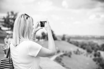 Woman with telephone take a selfie on vacation and enjoy the moment