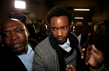 Duduzane Zuma, the son of scandal-plagued former South African president Jacob Zuma, arrives at the Johannesburg's Specialised Commercial Crime court on charges of corruption, in Johannesburg