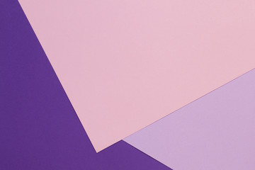 Color papers geometry flat composition background with violet, purple, pink tones.