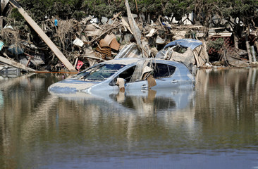 A submerged Toyota Motor's car is seen in a flooded area in Mabi town in Kurashiki