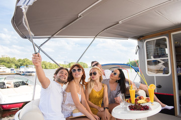 Freinds are making selfie on yacht