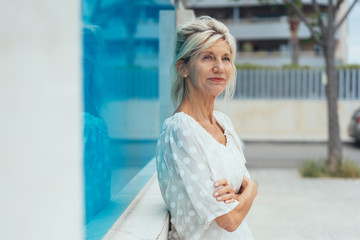 Attractive woman standing in town waiting