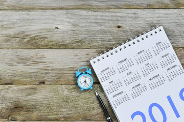 Empty or blank calendar notebook on wooden background