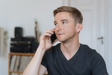 Young man listening to a call on his mobile