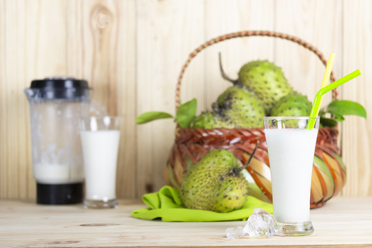Soursop juice and soursop fruit or Prickly Custard Apple or Annona muricata L on wooden table.