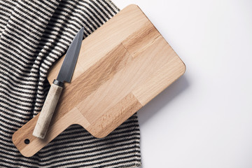 Wooden chopping board and knife with a striped cloth Wall mural