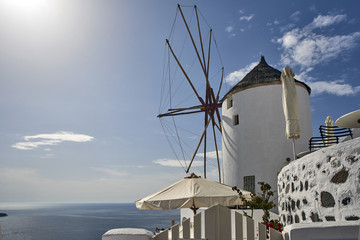 Greece. The island of Santorini. Town Oia. Windmill at sunset