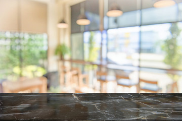 black marble table top on blur coffee shop