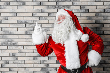 Authentic Santa Claus on brick wall background