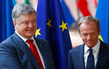 Ukrainian President Petro Poroshenko poses with European Council President Donald Tusk ahead of a meeting in Brussels