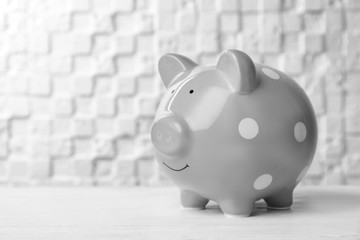 Gray piggy bank on white table. Money saving