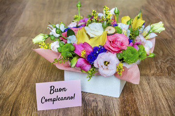 Flower Box of Colorful Roses,Freesia and Greenery with Buon Compleanno Text in Italian  which Means Happy Birthday
