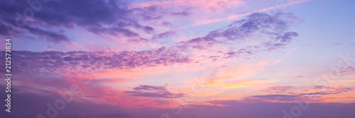 Wall mural Panoramic view of a pink and purple sky at sunset