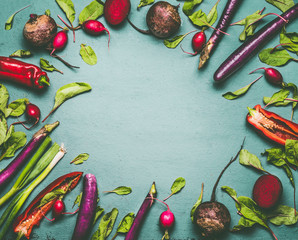 Various vegetables on blue green background , frame, top view, flat lay. Healthy vegetarian and vegan cooking and eating with seasonal organic harvest vegetables. Clean food concept.