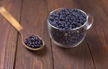 Wild blueberries on wooden background