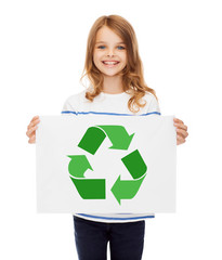 waste recycling, reuse, environment and ecology concept - happy girl with picture of green recycle symbol on paper over white background