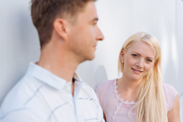 Thoughtful blond woman looking past her husband