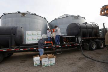Farmers fill tanks with fertiliser in Gideon Missouri