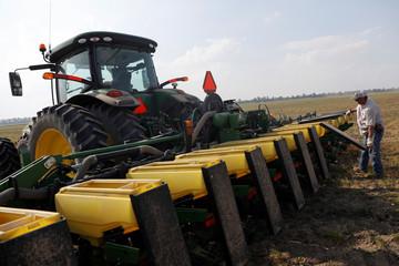 Farmer Bruce Elder, 56, a farmer for 40 years, fills a seeding tractor with soybean seeds in Gideon, Missouri