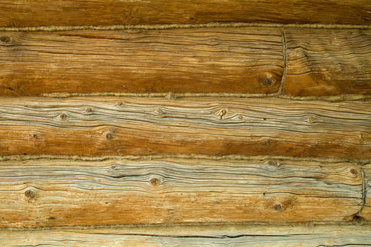 fragment of a wall of an old wooden logs