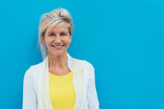Happy vivacious older blond woman