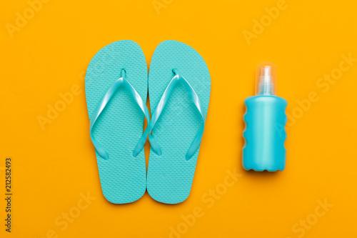 6c75b084049ddc Summer beach flip flops on colored background