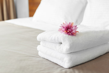 towels and flower on bed in hotel room Wall mural