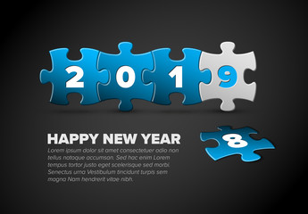 New Year card made from blue and white puzzle pieces