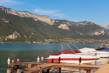 The resort town of Annecy near the lake. .Pleasure boats on the pier. Rhone Alps, Department of Haute-Savoie. France.