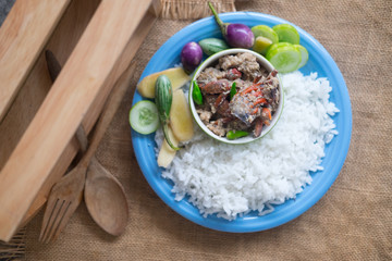 Salted crab stew with coconut milk served with cooking rice