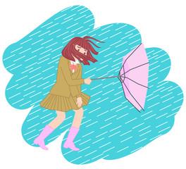 台風で壊れた傘を持つ女子高生