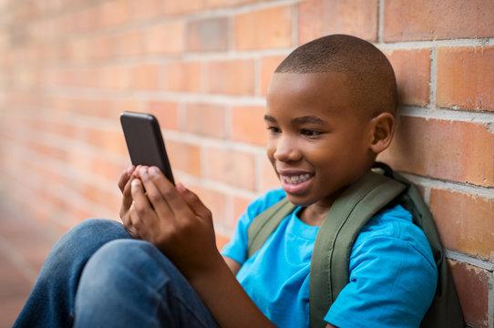 School boy using smart phone